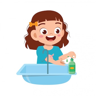 Feliz niña linda niña lavarse las manos en el fregadero