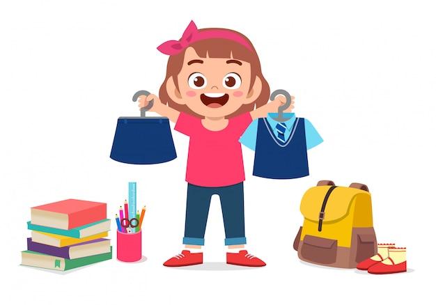 Feliz niña niño lindo preparar uniforme para la escuela