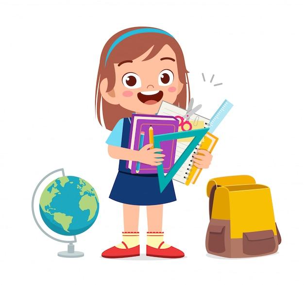 Feliz niña niño lindo con útiles escolares