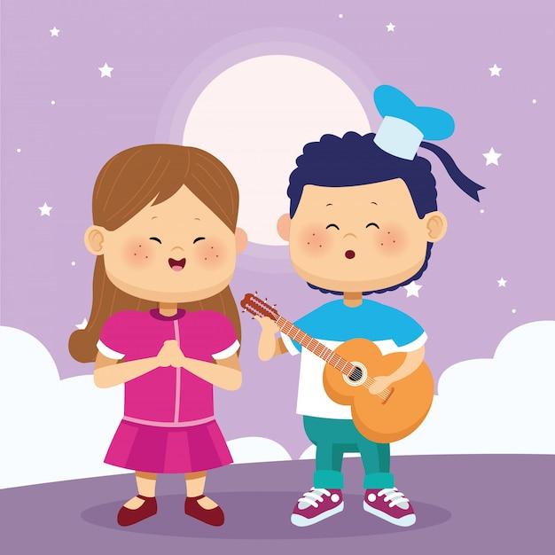 Feliz niña y niño tocando la guitarra