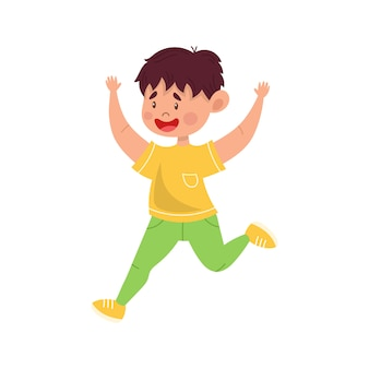 Feliz niño lindo un niño alegre salta alegremente, baila divertido.