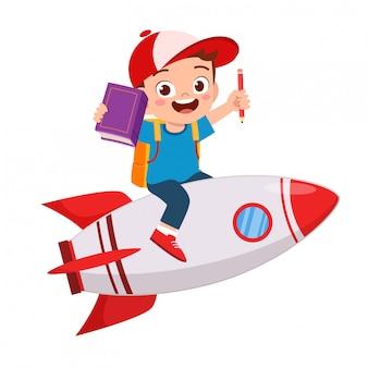 Feliz niño lindo niño paseo en cohete hacia el éxito