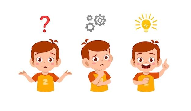 Feliz niño lindo niño pensando y buscando proceso de idea