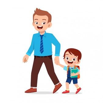 Feliz niño lindo niño primer día de escuela con padre