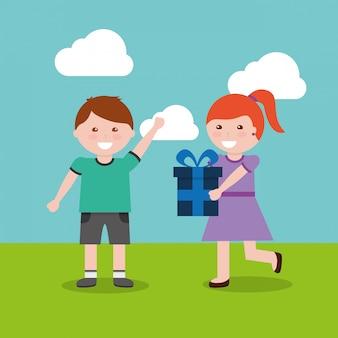 Feliz niño y niña con regalo