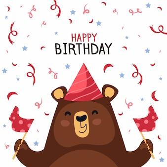 Feliz oso con gorro de fiesta y confeti
