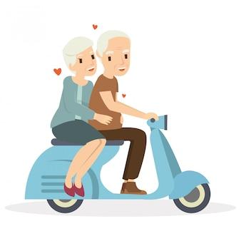 Feliz pareja de ancianos montando una moto en el día de san valentín