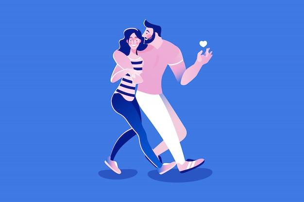 Feliz pareja joven caminando abrazando en la fecha