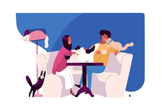Feliz pareja joven en cat cafe.