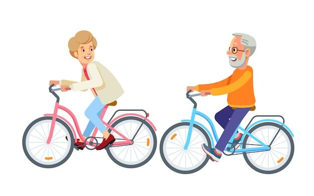 Feliz pareja madura ir en bicicleta juntos en el parque