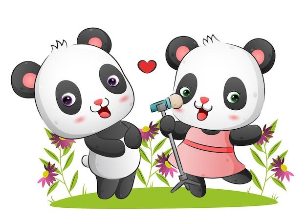La feliz pareja de panda está cantando y bailando juntos ilustración