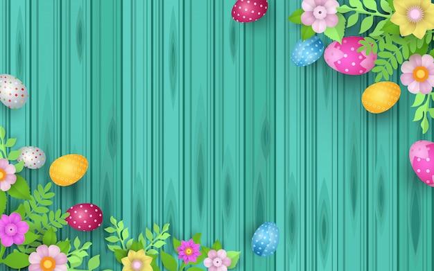 Feliz pascua con hermosos huevos decorados y flores.