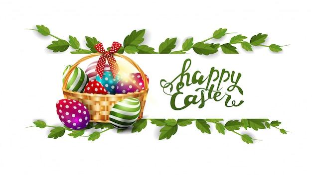 Feliz pascua, postal blanca con marco de liana y canasta con huevos de pascua.