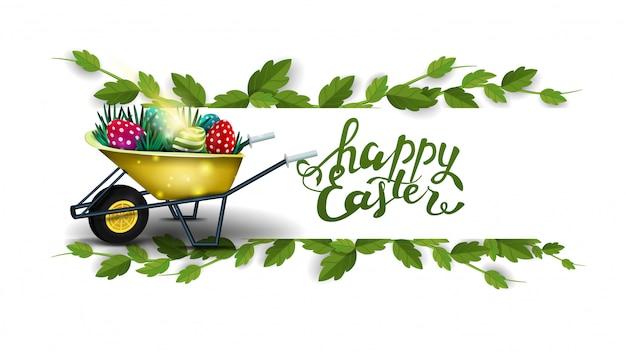 Feliz pascua, postal blanca con marco de liana y carretilla con huevos de pascua.
