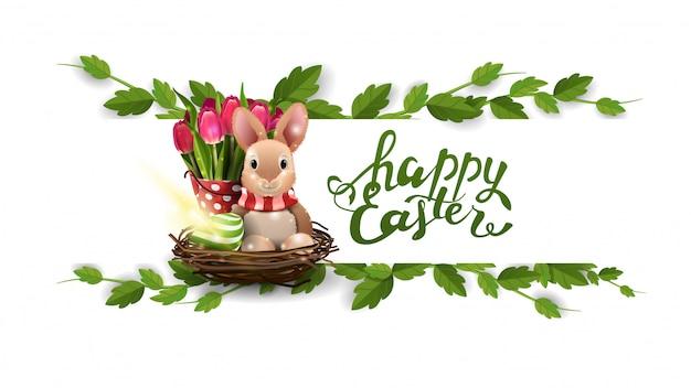 Feliz pascua, postal blanca con marco de liana, conejito de pascua y tulipanes.
