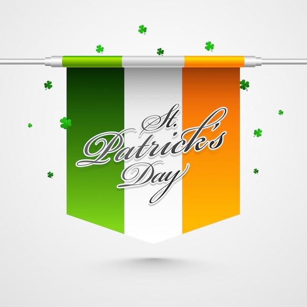 Feliz st. tarjeta del día de patricks con bandera de irlanda y hojas de trébol en blanco