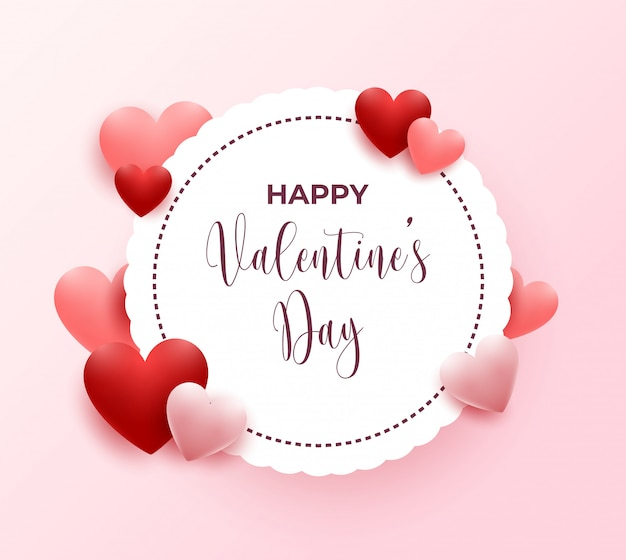 Feliz tarjeta de felicitación del día de san valentín con corazones rojos y rosados