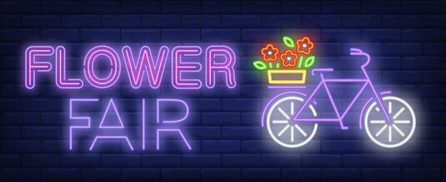 Feria de flores de neón de texto, bicicleta con flores en portaequipajes.