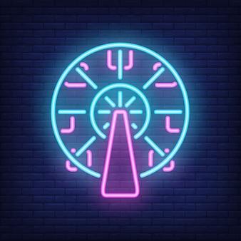 Ferris wheel neon sign. carrusel del parque de atracciones en fondo oscuro de la pared de ladrillo.