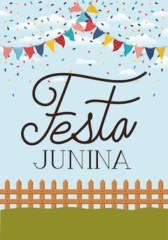 Festa junina con valla y guirnaldas.