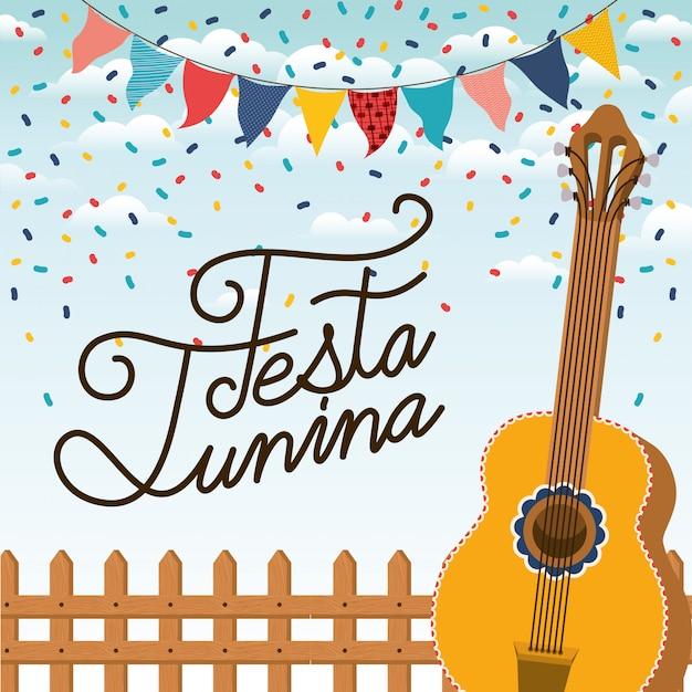 Festa junina con valla y guitarra.