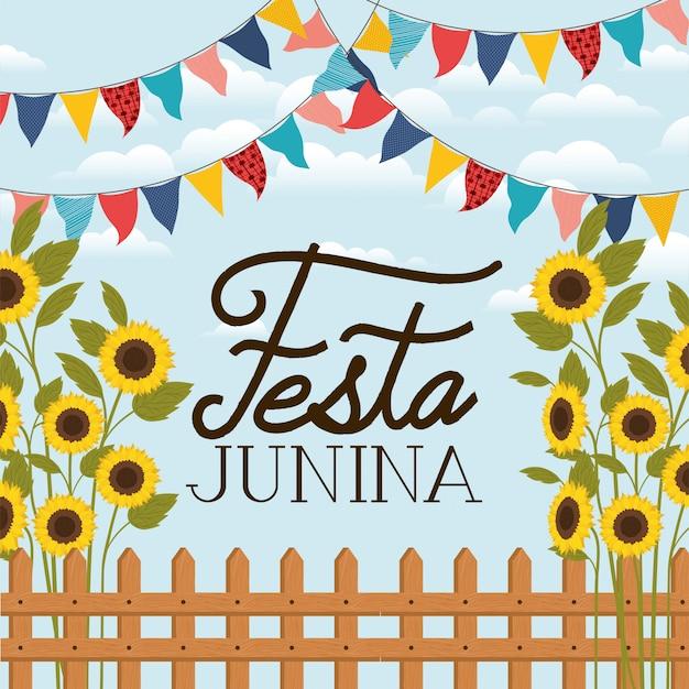 Festa junina con valla y jardín de girasoles.