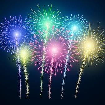 Festival de fuegos artificiales de colores sobre fondo azul.
