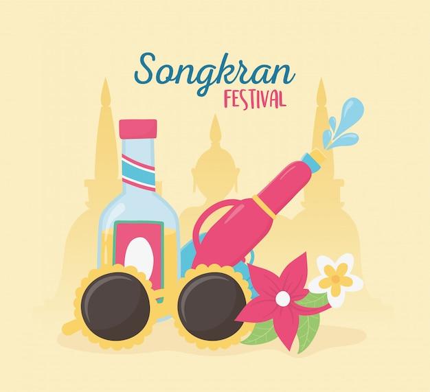 Festival de songkran pistola de agua gafas de sol beber botella flores celebración