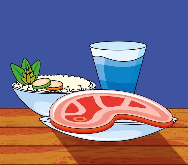 Filete de carne con arroz y bebidas.