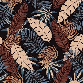 Sin fisuras patrón tropical con brillantes hojas y plantas de color beige y marrón