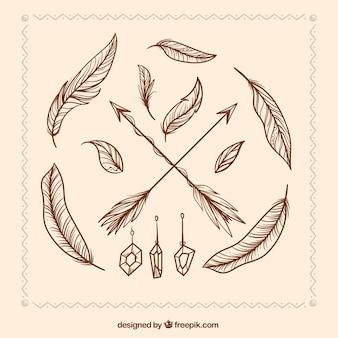 Flechas y plumas dibujadas a mano