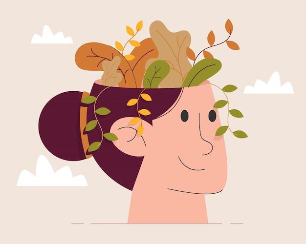 Flor dentro de la cabeza de la mujer