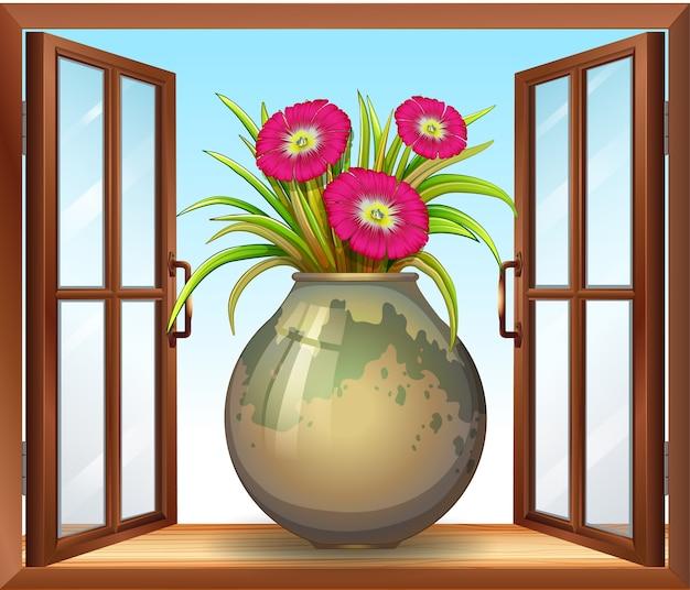 Flor en florero junto a la ventana