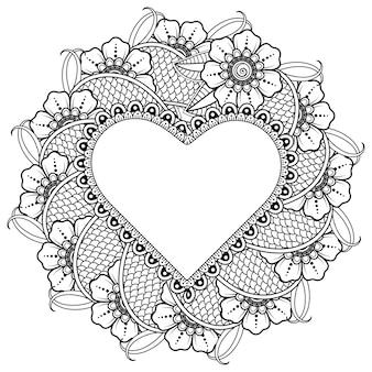 Flor de mehndi con marco en forma de corazón.