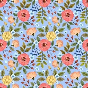 Floración de flores de colores sobre fondo de color azul.