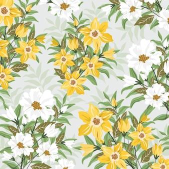 Flores amarillas y blancas con hojas verdes.