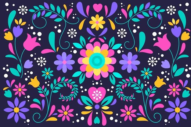 Flores artísticas de colores vivos y hojas de fondo mexicano