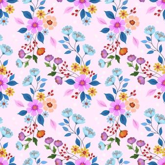Flores dibujadas a mano en patrón transparente de color rosa.