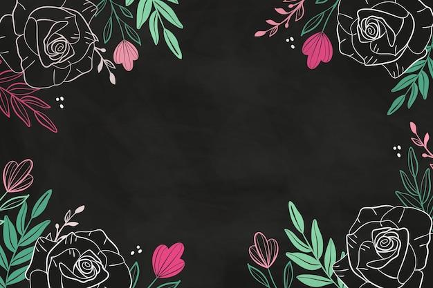 Flores dibujadas sobre fondo de pizarra