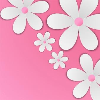 Flores de papel blanco sobre fondo rosa bebé.
