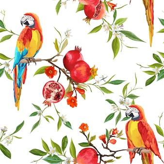 Flores tropicales, granadas y aves loro