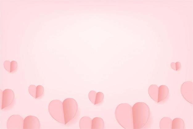 Flotador de corazones de papel sobre fondo rosa. día de san valentín