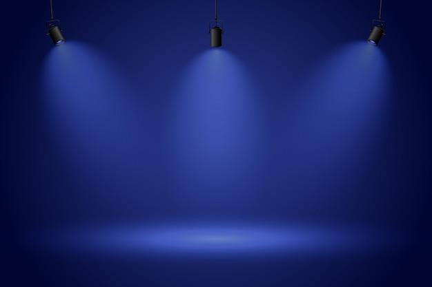 Focos sobre fondo azul oscuro