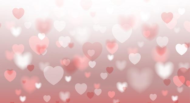 El fondo abstracto del corazón rojo con la luz enmascaró el bokeh.