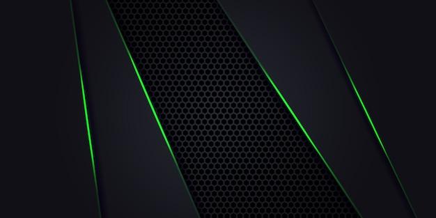 Fondo abstracto oscuro con fibra de carbono hexagonal. fondo de tecnología con líneas luminosas verdes.