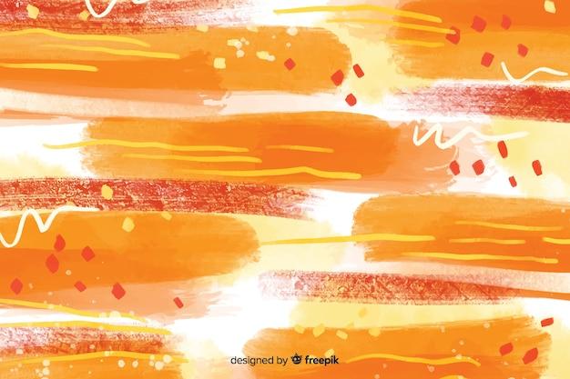 Fondo abstracto de trazos de pincel amarillo y rojo