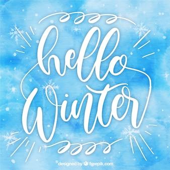 Fondo de acuarela azul hola invierno con letras caligráficas
