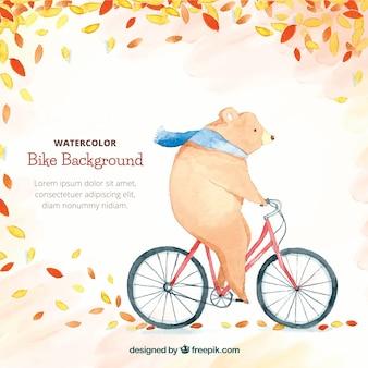 Fondo en acuarela con oso montando en bicicleta