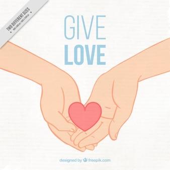 Fondo adorable de manos con un corazón