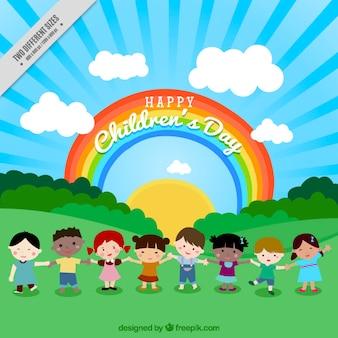 Fondo de adorables niños en la naturaleza con arcoiris
